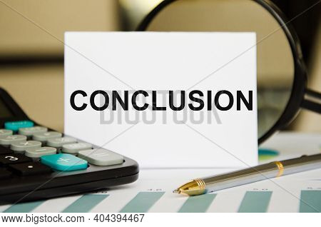 The Word Conclusion Is Written On A White Sheet Of Paper Near A Calculator And A Pen And A Magnifyin
