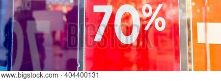 Sale Up To 70 Percent Red Sign. Red Display With Sale Up To Seventy Percent Inscription Sticked On T