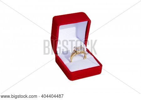 Valentines Day. Wedding Ring with a Red Valentines Day Heart. Engagement Ring in a Red Ring Box. Isolated on white. Room for text. Happy Valentines Day. Be My Valentine