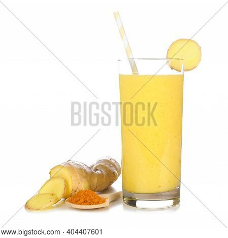 Turmeric And Ginger Smoothie In A Glass With Ingredients Isolated On A White Background. Healthy Imm