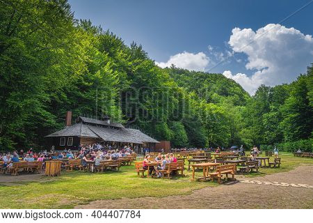 Plitvicka Jezera, Croatia, July 2019 Tourists Relaxing And Eating In Wooden, Open Air Restaurant, Pl