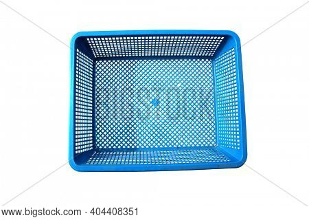 Blue Basket. Blue Plastic Basket. Isolated on white. Room for text. Baskets are used World Wide to hold various items. Plastic is used to make many baskets and containers. Room for text or images.