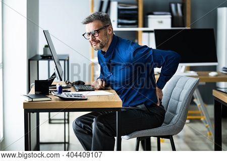 Back Pain Bad Posture. Man Using Computer