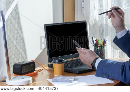 Selective Focus Of A Man In A Blue Suit In Confinement And Teleworking Time Watching His Mobile Phon