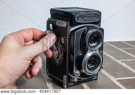 Zurich, Switzerland - December 31, 2020: A Human Hand Sets Manually A Twin Lens Reflex Retro Camera