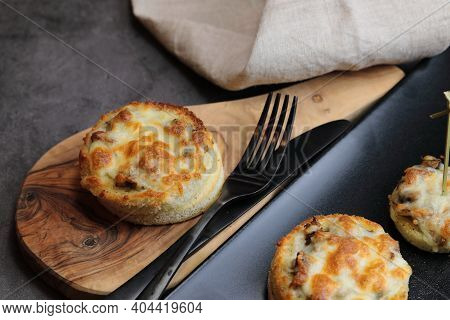 A Platter Of Cheesy Mushroom Croustades Or Cheesy Mushroom Discs Toated For A Starter Or Hors D'oeuv