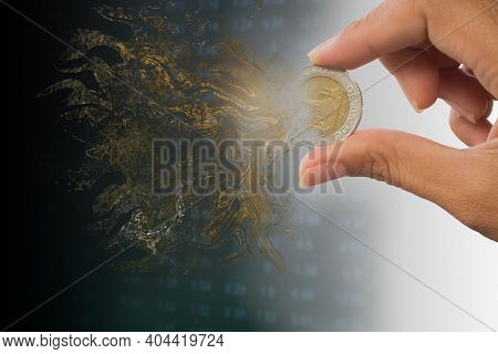 Dispersion Effects Coin With Hand Holding Coin On Blur Image For Inflation Or Failing, Going Bankrup