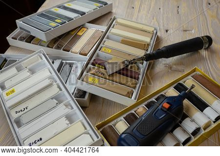 Tools For The Restoration Of Wooden Surfaces, Wax Kits And Soldering Iron Close-up.