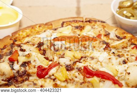 Barbeque Chicken, Red Bell Pepper, Onion, Pineapple Pizza In Its Carryout Box With Buttery Garlic Sa