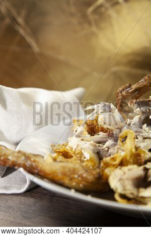 Remains Of Roasted Chicken Bones And Meat That Have Been Eaten Off Of