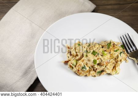 Sweet Shrimp Prepared With Cream Cheese And Green Onions On A White Plate Next To A Tan Napkin On A
