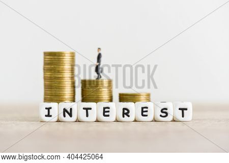Interest Rate Financial And Mortgage Rates Concept, Cube Block Interest Rates Rise With Business Man