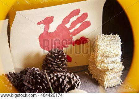 Red Hand Turkey On Vanilla Construction Paper With Hay And Pinecones, In A Yellow Frame