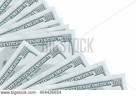 100 Us Dollars Bills Lies Isolated On White Background With Copy Space Stacked In Fan Close Up. Payd