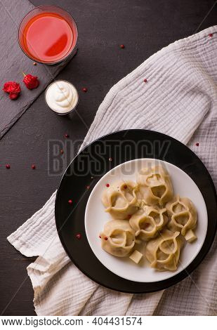 Manti Or Manty Dumplings In A Traditional Bowl On Wooden Table. Banner Menu Recipe Place For Text. F