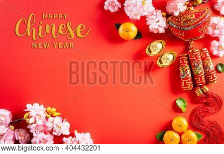 Top View For Happy Chinese New Year Or Lunar New Year Festival Decorations On A Red Background. ( Ch