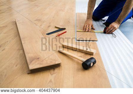 Laminate Flooring Improvement. Installer Contractor Installing New Floor