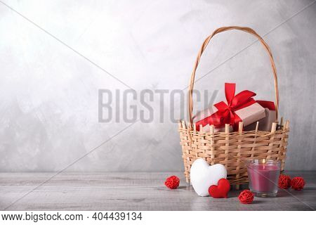 Greeting Card Valentine's Day With Hearts ,goblet And Gifts In Basket On Wooden Background. With Spa