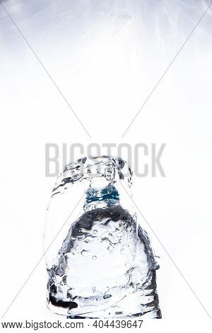 Mineral Water Overflowing Bottles Of Water Spread White Background