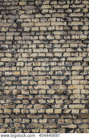 Grunge Texture Of An Old Brick Wall. Background From Old Brown Bricks. Uneven Texture Of Weathered B