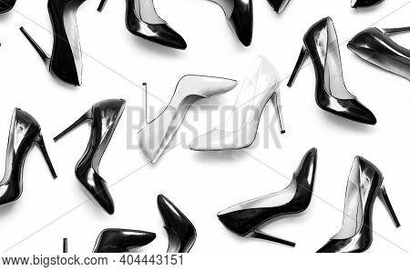 Beautiful Female Shiny White And Black Stilettos On A White Background