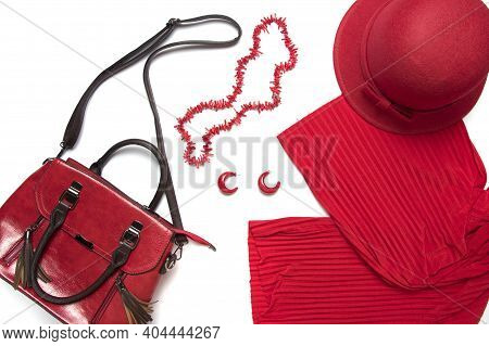 Flat Lay Female Clothes And Accessories Collage, Red Women's Handbag, Hat, Pants And Necklace Isolat