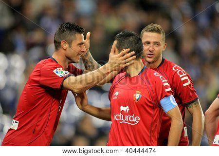 BARCELONA - NOV,10: Kike Sola(L), Miguel Flano(C) and David Timor(R) of Osasuna celebrate goal during a League match against Espanyol at the Estadi Cornella on November 10, 2012 in Barcelona, Spain