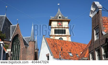 Westerkerk Church (or St Gomaruskerk) With A Separate Wooden Clock Tower On The Right, And Historic