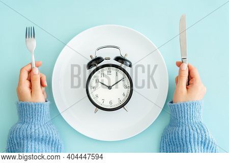 Food Planning For A Diet. A Woman With A Plate