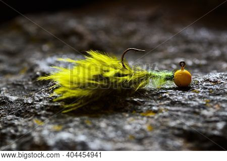 Green-yellow Jig Streamer (marabou) Made Of Feathers On Gray Stone