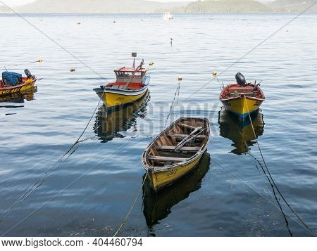 Small Fishing Boats, Moored On The Coast Of The Valdivia River, In The Town Of Corral. Fishing Is Th