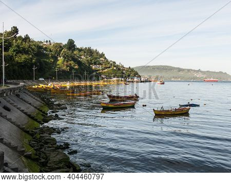 Small Fishing Boats, Moored On The Coast Of The Valdivia River, In The Town Of Corral. Chile Is A Po