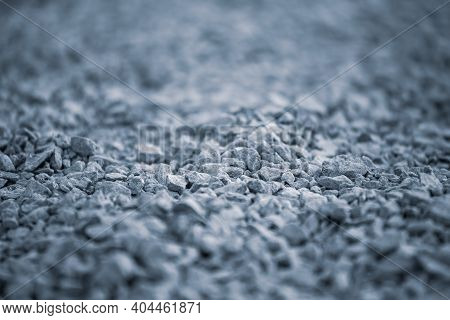 Background Of Pebbles. Pebble Texture With A Blue Tint. Blue Pebbles. Abstract Smooth Round Pebbles