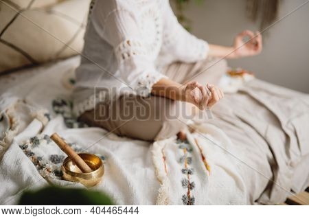 Cropped View Of Woman Meditating At Her Bedroom. Yoga, Meditation, Relax Concept.