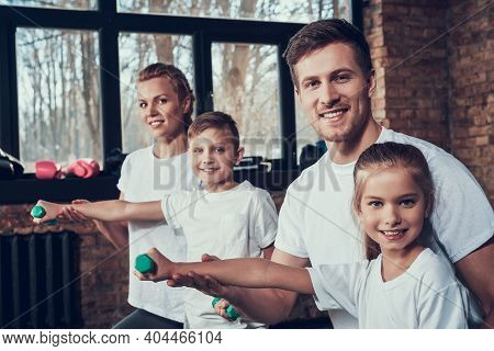 Young Family Working Out Together In The Gym.