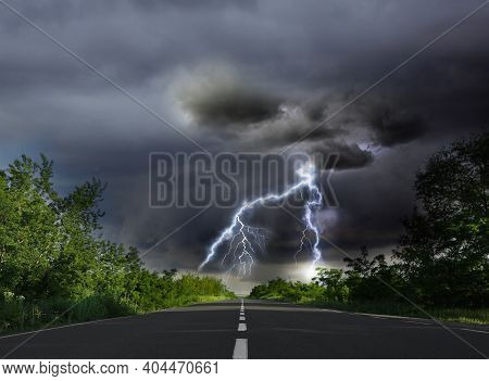 Picturesque View Of Asphalt Road Leading To Lightning Storm
