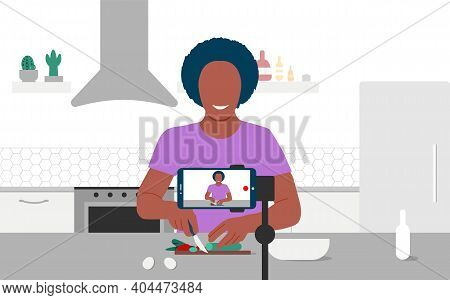 Food Blogger Streaming Live. A Black Man Records An Online Cooking Video Tutorial On His Phone. A Sm