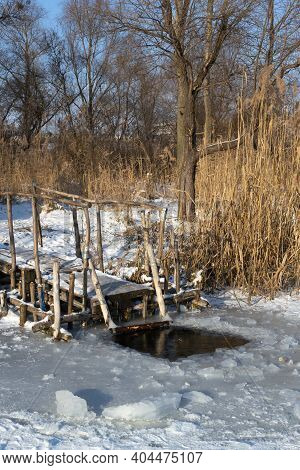 An Ice-hole On A Frozen River. Place For Dipping. Ice Bathing Concept. Vertical Orientation.