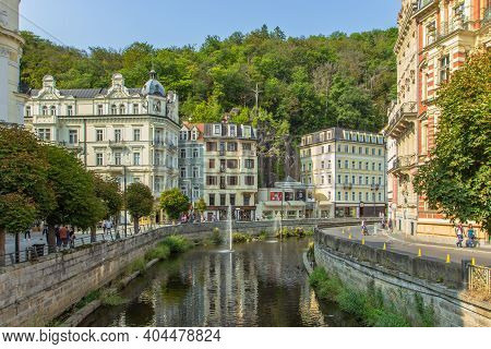 Karlovy Vary, Czech Republic-september 12, 2020. View Of Street With Colorful Riverfront Houses In C