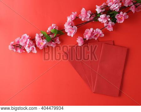 Top View Of Red Envelope And Flower On Chinese New Year Festival