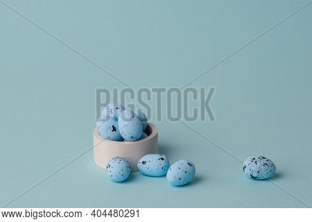 Quail Blue Easter Eggs On Blue Background. Minimal Comcept With Copy Space. Spring Holidays Decor