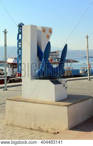 Eilat, Israel - May 14, 2011: This Is A Monument With An Anchor On The Embankment At The Pier.