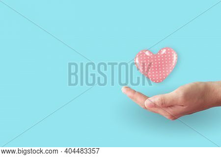 Close Up Of Woman Hands With Heart With Clean Pastel Background. Valentine's Day Love And Care.