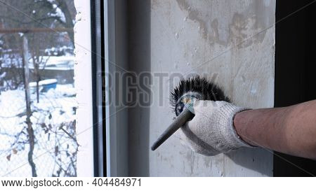 The Painter Paints With His Left Hand The Right Slope Of The Solar Window, Applying A Protective Pri