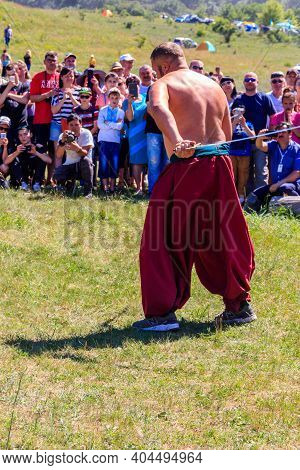Dnipropetrovsk Region, Ukraine - June 2, 2018: Ukrainian Cossack Performs With Sabers During Ethno-r