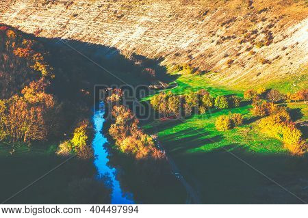 Cinematic Nature . Aerial View Of Riverside Valley And Rocky Hills