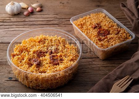 Thai Dessert, Mixed Crispy Rice Noodle (mee Krob) In Plastic Food Container On Wood Background