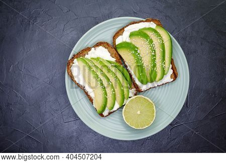 Toasted Cereal Bread Toast. Useful Diet Food. Sliced Avocado On Toasted Bread For Healthy Breakfast