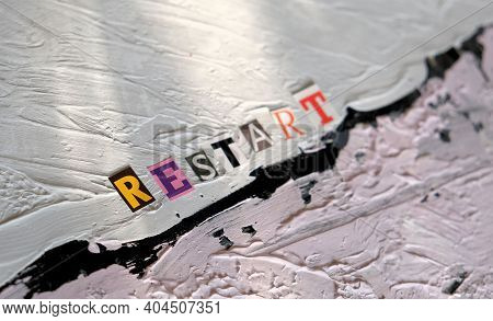 Selective Focus Of Word Restart. Inscription On Uneven Non-uniform Putty Coating . Text Space With L
