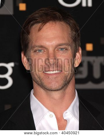 LOS ANGELES - AUG 10:  ADAM HARRINGTON arriving to CW Premiere Party  on August 10, 2011 in Burbank, CA